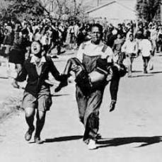 Among the first to die: 13-year-old Hector Pieterson, carried by Mbuyisa Makhubo. Hector's sister, Antoinette Sithole, runs beside them.