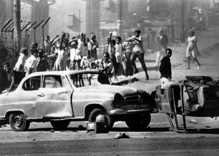 Students behind a makeshift roadblock